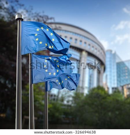 European union flag against parliament in Brussels, Belgium - stock photo