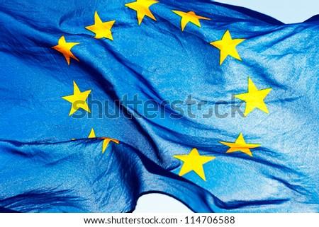European union flag against the sky and sunlight - stock photo
