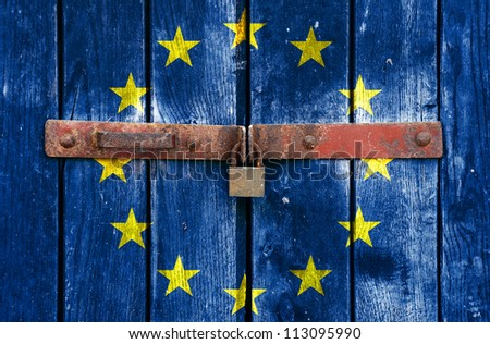 European Union flag on the background of old locked doors - stock photo