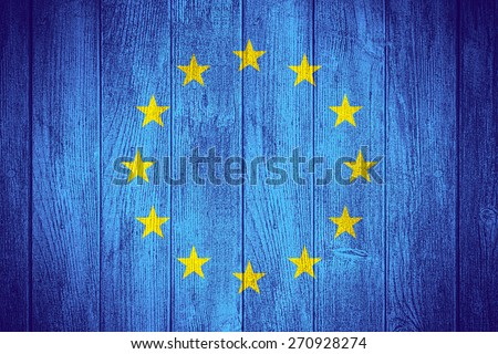 European Union flag or European banner on wooden boards background - stock photo