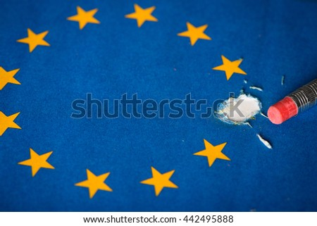European Union flag with one star removed by pencil eraser, concept of Brexit as Britain vote to leave - stock photo
