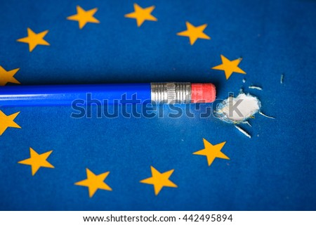 European Union flag with one star removed by pencil eraser, concept of Brexit as Britain vote to leave
