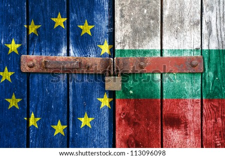 European Union flag with the Bulgarian flag on the background of old locked doors - stock photo