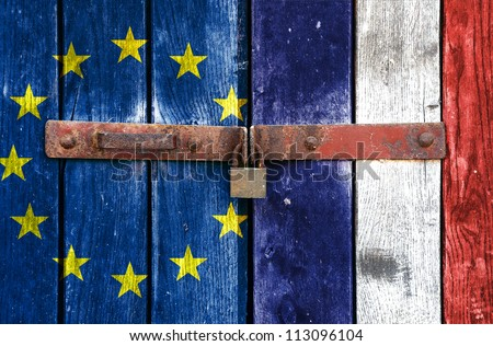 European Union flag with the France flag on the background of old locked doors - stock photo
