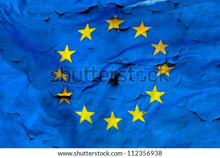 European Union flag with the texture of old and cracked wall. A conceptual image of the European crisis. - stock photo