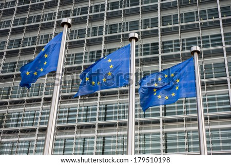 European Union flags in front of the Berlaymont building (European commission) in Brussels, Belgium. - stock photo