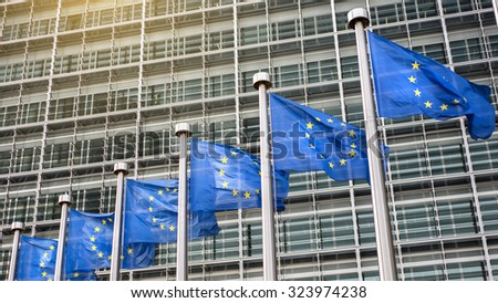 European Union flags in front of the Berlaymont building (European commission) in Brussels, Belgium. Header for website - stock photo