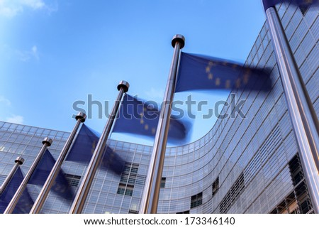 European union flags waving in front of building - stock photo
