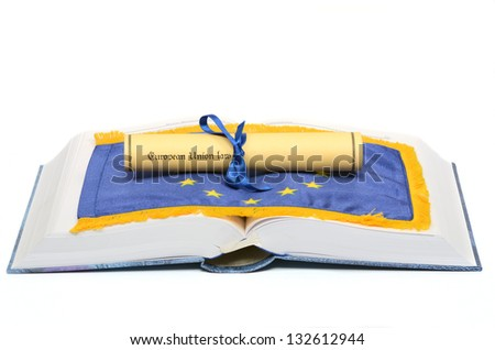 European union law on the European union flag , and Law book on the white background - stock photo