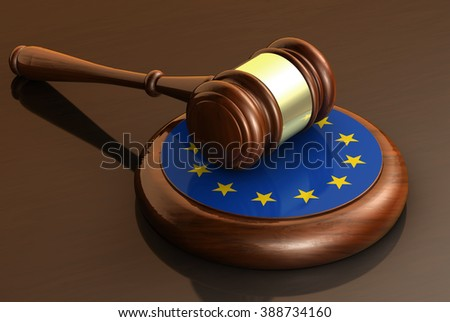 European Union laws, legal system and parliament concept with a 3d render of a gavel on a wooden desktop and the EU flag. - stock photo