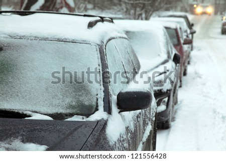 European winter. Snow covered cars. - stock photo