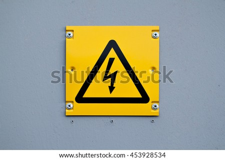 European yellow lightning sign of high voltage. Warning about dangerous electricity.