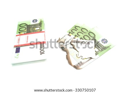 euros and burned bills on white background