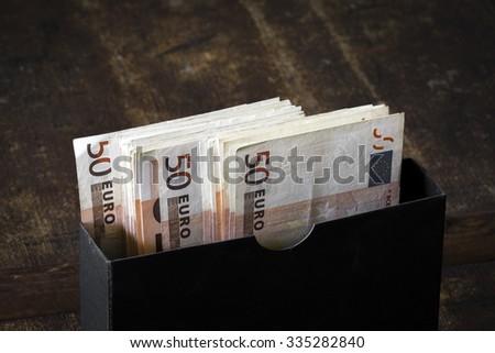 Euros in a black box - stock photo