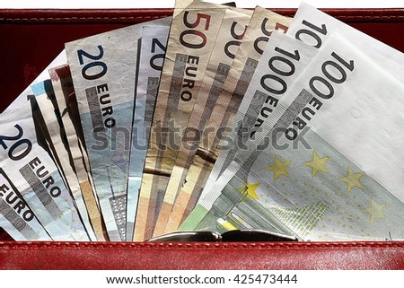 Euros in red wallet - stock photo