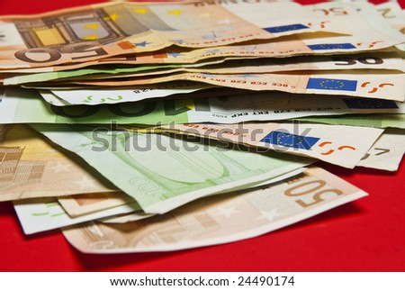 Euros on red background