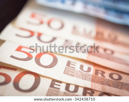 Euros with dark background. Concepts for money