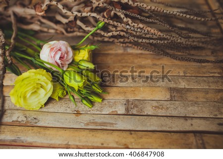 eustoma and rose  lying on a wooden board in a beautiful rustic style