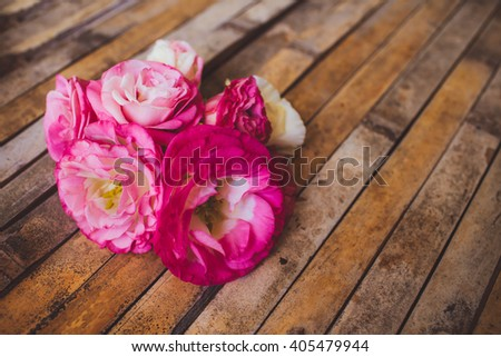 eustoma lying on a wooden board in a beautiful rustic style
