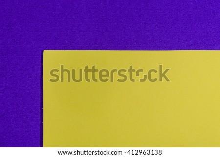 Eva foam ethylene vinyl acetate smooth lemon yellow surface on purple sponge plush background - stock photo