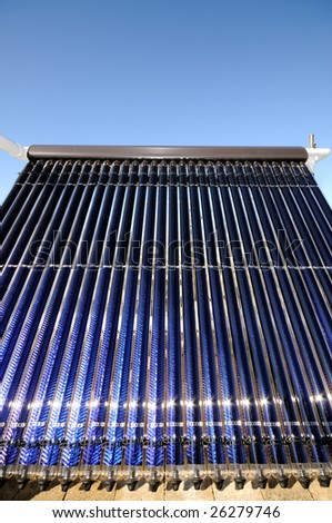 Evacuated tube solar collector - stock photo