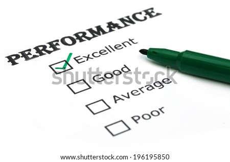 Evaluating performance with a green pen - stock photo