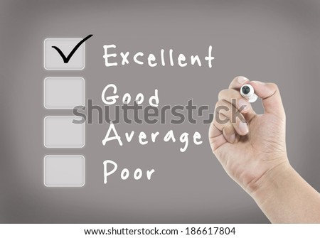 Evaluation checklist board with excellent checked - stock photo