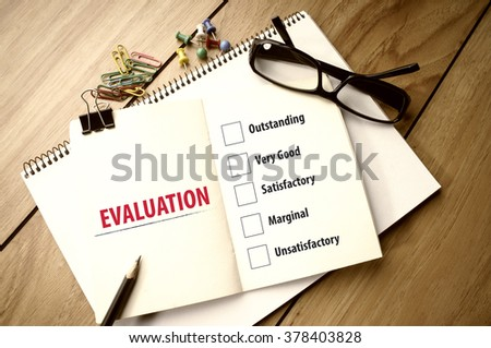 Evaluation Checklist on Notebook - stock photo