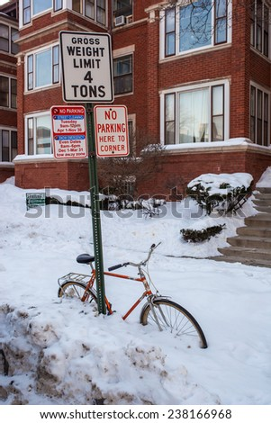 EVANSTON - February 11: Buried in snow bicycle, Evanston, Illinois on February 11 2014 - stock photo