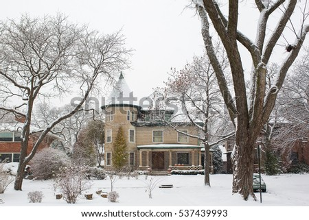 EVANSTON, IL: December 2016 - Large house covered with snow in Evanston, IL