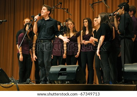EVANSTON, ILLINOIS- NOVEMBER 13: A cappella singing group Purple Haze of Northwestern University performs in The Best of the Midwest Concert on November 13, 2010 in Evanston, Illinois. - stock photo