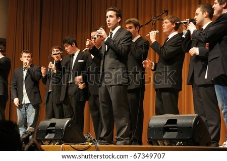 EVANSTON, ILLINOIS- NOVEMBER 13: A cappella singing group Straight No Chaser of Indiana University performs in The Best of the Midwest Concert on November 13, 2010 in Evanston, Illinois. - stock photo