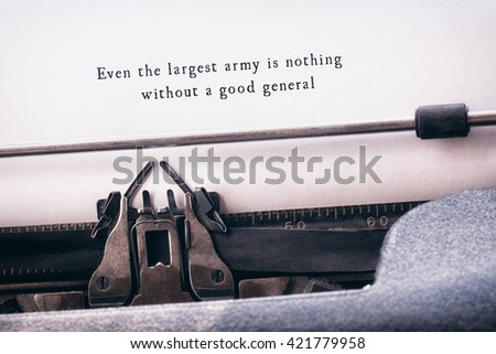Even the largest army is nothing without a good general message on a white background against close-up of typewriter