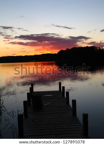 Evening and sunset near the lake in Lithuania - stock photo