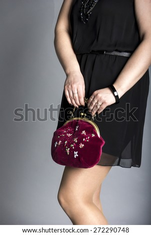 Evening bag. Little black dress. - stock photo