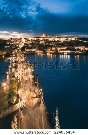 Evening  bird view of Prague across Vltava river, Charles Bridge and St.Vitus Cathedral. This image is toned - stock photo