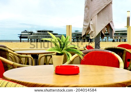 Evening cafe on the waterfront Scheveningen in The Hague. Autumn in the Netherlands, Den Haag - stock photo