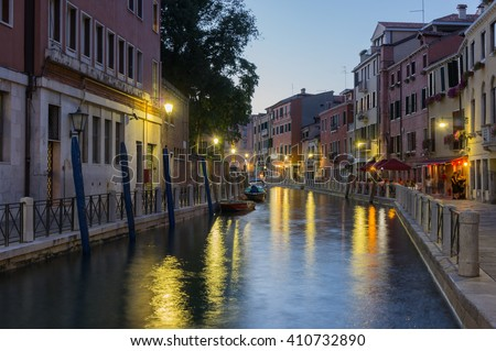 Evening canal scene at sunset, Venice, Italy. Venice canal at night. Venice twilight. Romantic Venice scene. Venice cityscape. Venice night. Colorful Venice lights. Venice sunset. Scenic Venice view. - stock photo
