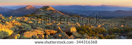 Evening Carpathian mountains. in the foreground a lot of stones, panorama - stock photo