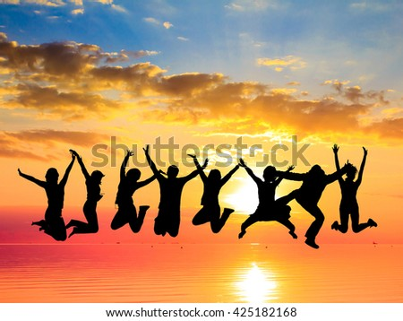 Evening Celebration Jumping over Sunset  - stock photo