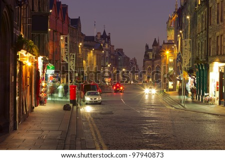 Evening city life in the centre of Edinburgh. The Royal Mile is a succession of streets which form the main thoroughfare of the Old Town of the city of Edinburgh in Scotland.