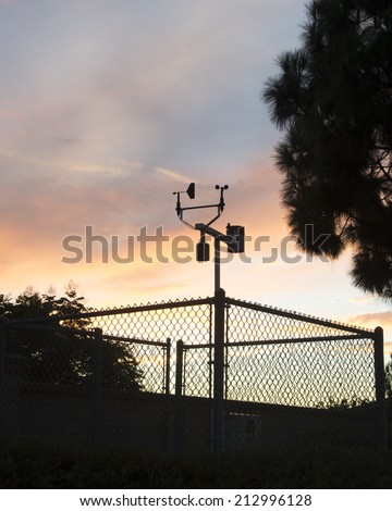 Evening clouds behind a weather station/Metrology Measurements/Evening clouds at a local weather recording station - stock photo