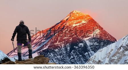 Evening colored view of Mount Everest from Gokyo valley with tourist on the way to Everest base camp, Sagarmatha national park, Khumbu valley, Khumbu valley, Sagarmatha national park, Nepal  - stock photo