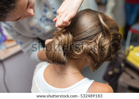evening hairstyle. Blond doing hairdresser and styling in barber salon