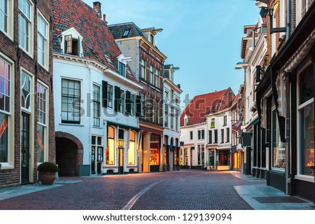 Evening in a shopping street of the Dutch ancient town Zutphen - stock photo