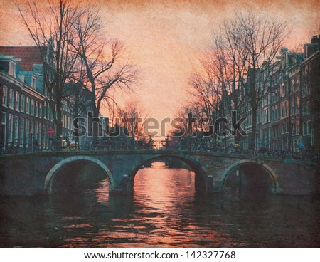 Evening in Amsterdam, Netherlands . Photo in retro style. Paper texture. - stock photo