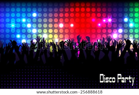 Evening in night club. people against color illumination