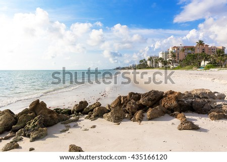 Evening light at the beach in Naples, Florida. Idyllic spot of the beach in this family vacation and relax spot. White sand and calm water. - stock photo