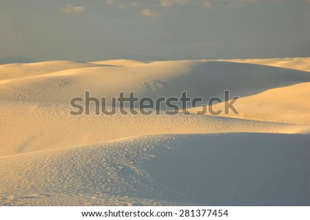 Evening light bathes White Sands National Monument, New Mexico - stock photo