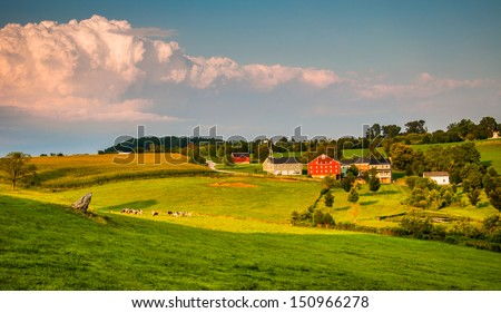 Evening light on farms and rolling hills in Southern York County, Pennsylvania. - stock photo